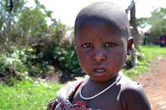 One black african child with a dirty face, closeup portrait. Royalty Free Stock Photos