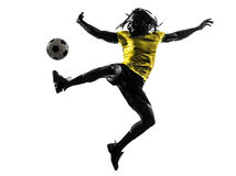 One black brazilian soccer football player man silhouette. One black brazilian soccer football player man in silhouette studio  on white background Stock Photography