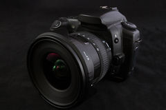 One black camera with wide angle lens  on black backgrou Royalty Free Stock Photo