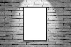 One black frame. On white brick wall royalty free stock images
