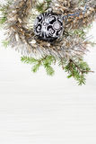 One black glass Xmas ball and twig on blank paper Stock Image