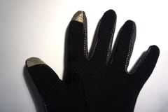 One black glove on a white background royalty free stock photography