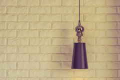 Lampshade on a brick wall background royalty free stock photos