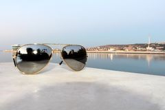 One black sunglasses on the stone table Royalty Free Stock Images