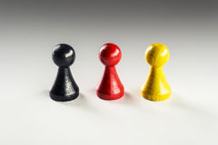 Black red yellow Ludo figure. One black, one red and one yellow Ludo figure, the Germany flag colors Stock Photo