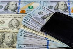 US dollar money banknote in full wallet. One black purse with the big pack of dollars US dollar money banknote in full wallet stock image