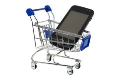 Phone in shopping cart royalty free stock photography