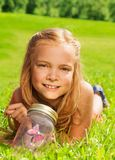 One blond girls with butterfly in jar Royalty Free Stock Images