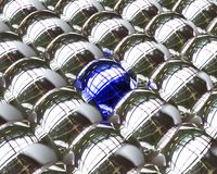 One blue ball among silver Royalty Free Stock Images