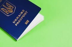 One blue biometric ukrainian foreign passport with coat of arms on green background with copy space. Visa-free travel concept royalty free stock photo