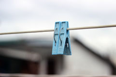 One blue clothespins close-up hanging on a rope for drying clothes Royalty Free Stock Photography