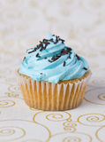 One blue cupcake on a  tablecloth 4 Royalty Free Stock Photos