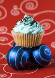 One blue cupcake and two christmas balls 2 Royalty Free Stock Photo