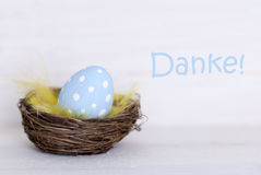 One Blue Easter Egg In Nest With German Danke Means Thank You Royalty Free Stock Images