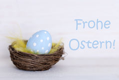 One Blue Easter Egg In Nest With German Frohe Ostern Means Happy Easter Stock Image