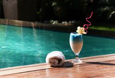 One blue exotic cocktail by the pool Royalty Free Stock Photography