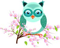 One blue owl on twig of tree Royalty Free Stock Photography