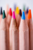One blue pencil standing out from the other pencils. Leadership, uniqueness, independence, initiative, Royalty Free Stock Image