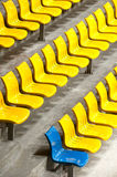 One of blue in plenty of yellow plastic seats at stadium . Stock Images