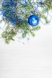 One blue Xmas ball and tree branch on blank paper Royalty Free Stock Photos