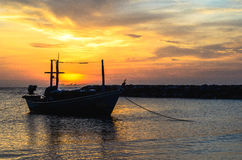 One boat anchor  near the orange beach in morning. Stock Photos