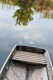 One boat on autumn water of pond Stock Photos