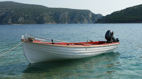 One boat in a bay. One boat in a mediterranean bay stock photos