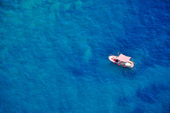 One boat in blue sea, Capri island, Italy Stock Images
