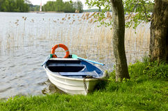 One boat on lake with life buoy Stock Image
