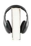 One book with headphones Royalty Free Stock Photo