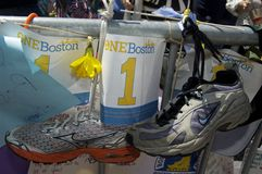 One Boston. Boston, Massachusetts USA - April 2013 - Sneakers and small posters reading One Boston handing from barricade at the Boston Marathon memorial Stock Photos