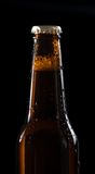 One bottle of fresh beer with drops on black Stock Photography