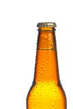 One bottle of fresh beer with drops, isolated Stock Photography