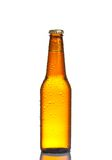 One bottle of fresh beer with drops, isolated Stock Image