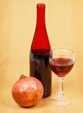 One bottle of pomegranate wine Stock Images