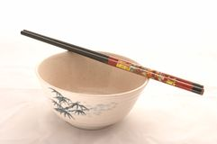 One Bowl with Pretty Chopsticks. On White Background royalty free stock photography