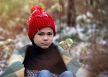 One boy in plaid walks in the snow in the autumn forest. alone i Stock Image