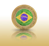 One Brazilian Real flag in a coin Royalty Free Stock Image