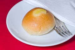 One bread on white plate Stock Images