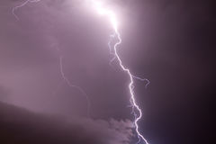 One bright lightning and dark sky. One bright lightning on the dark sky bakcground royalty free stock images