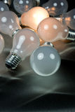 One bright mind. Series of lightbulbs on metal background Royalty Free Stock Images