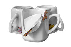 One broken cup with two others Royalty Free Stock Photography