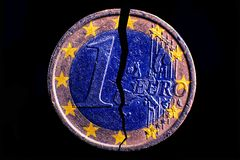 One broken euro coin close up royalty free stock image