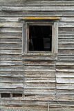 One Broken Window in a Dilapidated Wooden House Royalty Free Stock Image