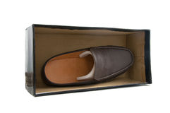 One brown male shoes. In box on white Stock Photos