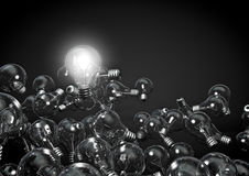 One bulb to rule them all. 3D render of one shiny bulb amongst dim ones Royalty Free Stock Photos