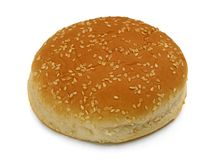 One bun with sesame seeds on a white background stock images