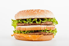 One burger. Burger with cheese, meat and salad isolated on white Stock Photography