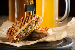 One burger with sliced cutlet, lettuce and cheese Stock Photo