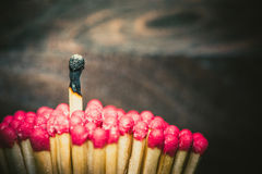 One burned match standing out from the crowd Royalty Free Stock Photos